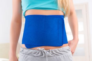 Woman wearing slimming belt